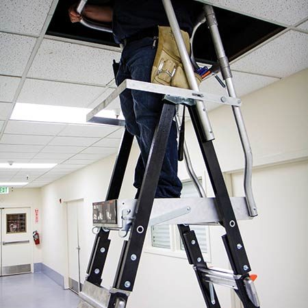 Compact Dual Safety Ladder with Enclosed Work Platform